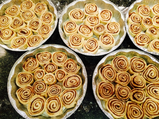 Pans of cinnamon buns ready to go
