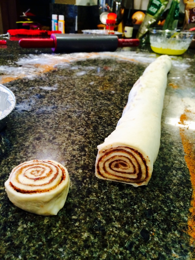 Slicing cinnamon rolls